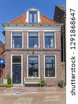 typical dutch house in the... | Shutterstock . vector #1291868647