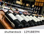 red and white wine in bottles... | Shutterstock . vector #129188594