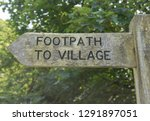 """footpath to village"" sign post ... 