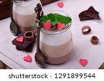three chocolate mousse dessert...   Shutterstock . vector #1291899544