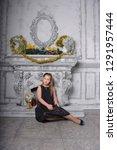blond child girl in a black... | Shutterstock . vector #1291957444