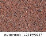 close up of red asphalt pavement | Shutterstock . vector #1291990357
