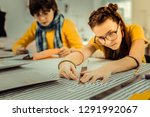 holding ruler. close up of... | Shutterstock . vector #1291992067