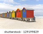 row of painted beach huts in... | Shutterstock . vector #129199829
