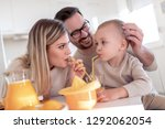 family making juice in their... | Shutterstock . vector #1292062054