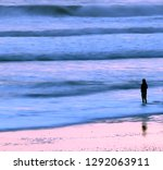 Silhouette Of Woman Fishing In...