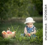 baby sitting on the grass with... | Shutterstock . vector #129208364