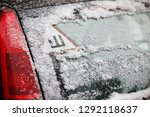 the first snow on the car and...   Shutterstock . vector #1292118637