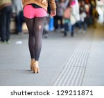 Unlucky woman with torn sock walking on platform - stock photo