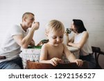 happy mother  father and son... | Shutterstock . vector #1292156527