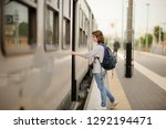 young woman with backpack take... | Shutterstock . vector #1292194471