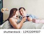 couple in love drinking wine...   Shutterstock . vector #1292209507