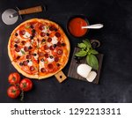 pizza margarita and pepperoni | Shutterstock . vector #1292213311