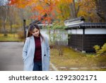 beautiful girl in autumn.... | Shutterstock . vector #1292302171