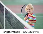 child playing tennis on indoor... | Shutterstock . vector #1292321941