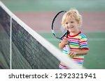 child playing tennis on indoor... | Shutterstock . vector #1292321941