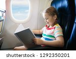 child in airplane. kid with... | Shutterstock . vector #1292350201