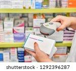 pharmacist scanning barcode of...   Shutterstock . vector #1292396287