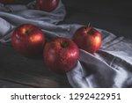 fresh red apples on wooden table | Shutterstock . vector #1292422951