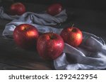 fresh red apples on wooden table | Shutterstock . vector #1292422954
