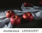 fresh red apples on wooden table | Shutterstock . vector #1292422957