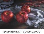 fresh red apples on wooden table | Shutterstock . vector #1292423977