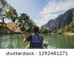 kayaking concept   asian man... | Shutterstock . vector #1292481271