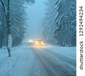 snowy winter road with car....   Shutterstock . vector #1292494234