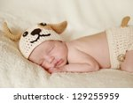 newborn wearing funny  knitted... | Shutterstock . vector #129255959