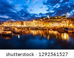 Small photo of Cannes port aerial panoramic view at night. Cannes is a city located on the French Riviera or Cote d'Azur in south France.