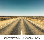 a long straight road in the... | Shutterstock . vector #1292622697