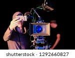 cameraman is looking through a... | Shutterstock . vector #1292660827