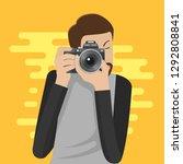 photographer character takes... | Shutterstock .eps vector #1292808841