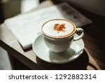 two cups of cappuccino with... | Shutterstock . vector #1292882314