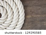 heavy rope on weathered wooden... | Shutterstock . vector #129290585