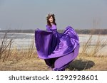 woman flying lilac dress   with ... | Shutterstock . vector #1292928601