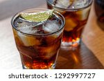 rum. cola cuba libre with lime...   Shutterstock . vector #1292997727