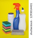 Small photo of Three types of detergents for the kitchen: liquid, spray and powder and colorful foam sponge for washing dishes on a yellow background. Kitchen detergent. Household chemicals. Household chores.