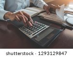 woman with bills and calculator.... | Shutterstock . vector #1293129847