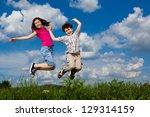 girl and boy jumping  running... | Shutterstock . vector #129314159