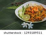 pad thai noodles on white plate ... | Shutterstock . vector #1293189511