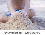 A Boy Building The Sandcastle...