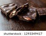 bitter almond chocolate pieces... | Shutterstock . vector #1293349417