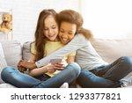 happy little girls using... | Shutterstock . vector #1293377821