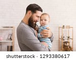 young happy man holding his... | Shutterstock . vector #1293380617