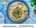 pasta tagliatelle and mushrooms ... | Shutterstock . vector #1293387814