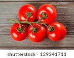 fresh tomatoes on the old... | Shutterstock . vector #129341711