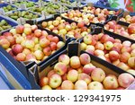 Cardboard boxes with apples and pears in supermarkets - stock photo