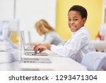 african boy learns computer... | Shutterstock . vector #1293471304