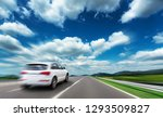 Stock photo white car moving on highway added motion effect 1293509827